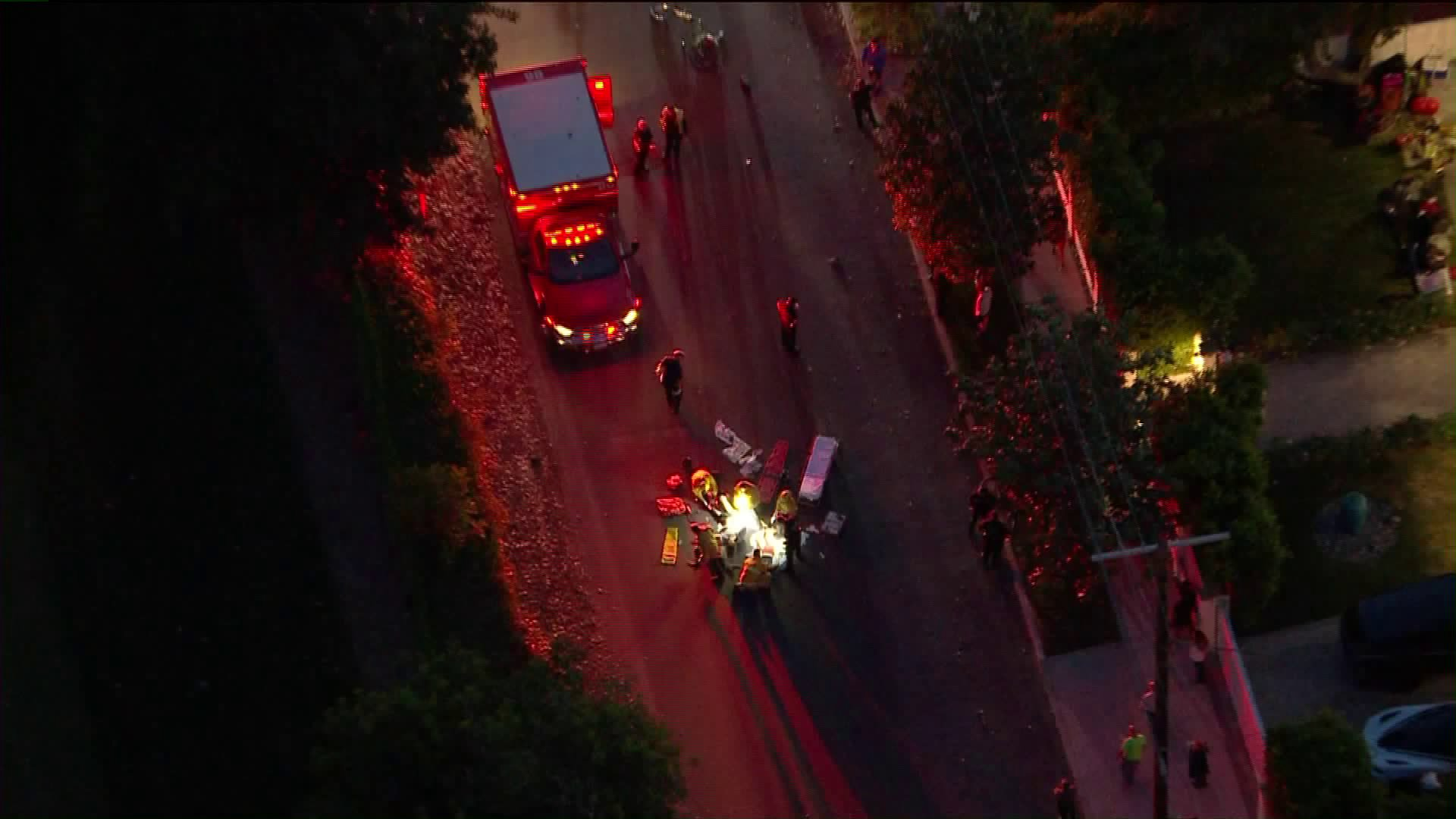 Sky5 footage showed a man and a woman being treated after getting hit by a car on May 11, 2020. (KTLA)