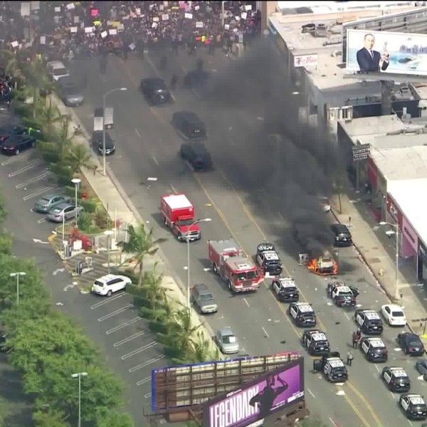 A vehicle is seen burning amid a massive protest in Los Angeles' Fairax District on May 30, 2020, over the death of George Floyd in Minneapolis. (KTLA)