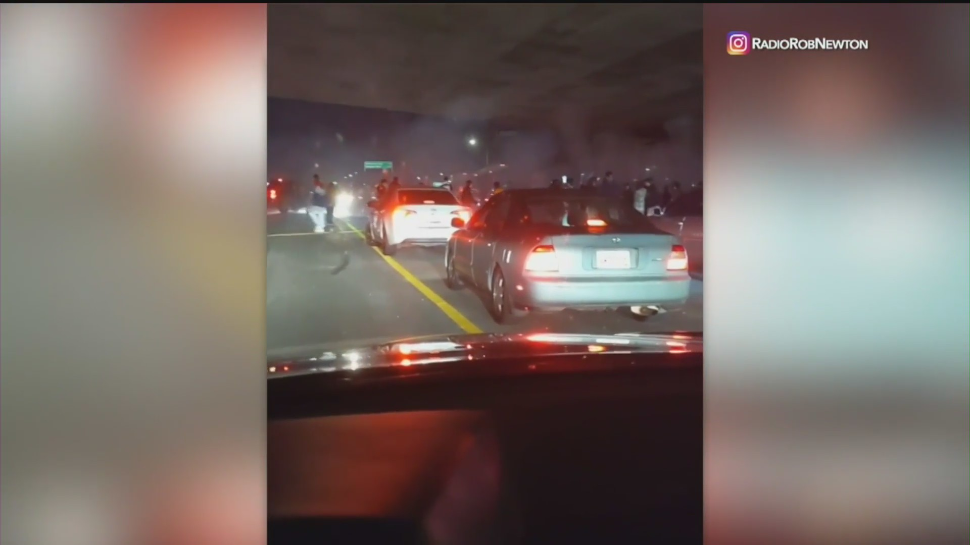 A group of about 50 people stopped traffic on the 5 Freeway in Commerce to perform car stunts on May 21, 2020. (@RadioRobNewton on Instagram)