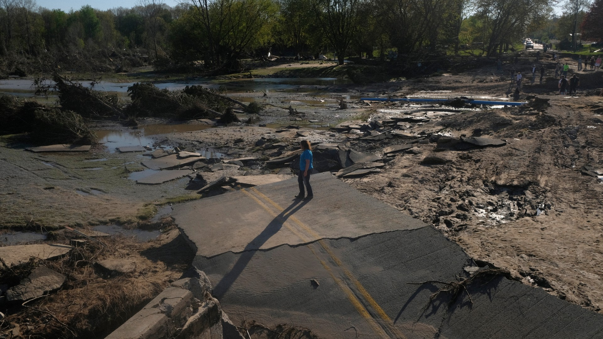 Residents explore what remains of the West Curtis Road bridge which was swept away following extreme flooding throughout central Michigan on May 20, 2020 in Edenville, Michigan (Matthew Hatcher/Getty Images)