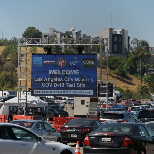 People line up in their cars at a drive-through novel coronavirus testing site to get a free COVID-19 test at the Los Angeles Dodgers stadium parking lot, in Los Angeles, California on May 26, 2020. (Agustin Paullier/AFP/Getty Images)