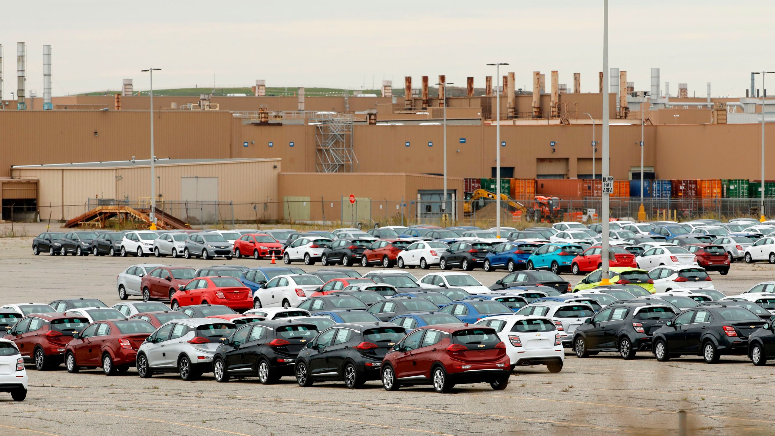 Cheverlot Sonic and Bolt EV vehicles sit in the lot outside General Motors (GM) Orion Assembly on October 11, 2019 in Orion Township, Michigan. (JEFF KOWALSKY/AFP via Getty Images)