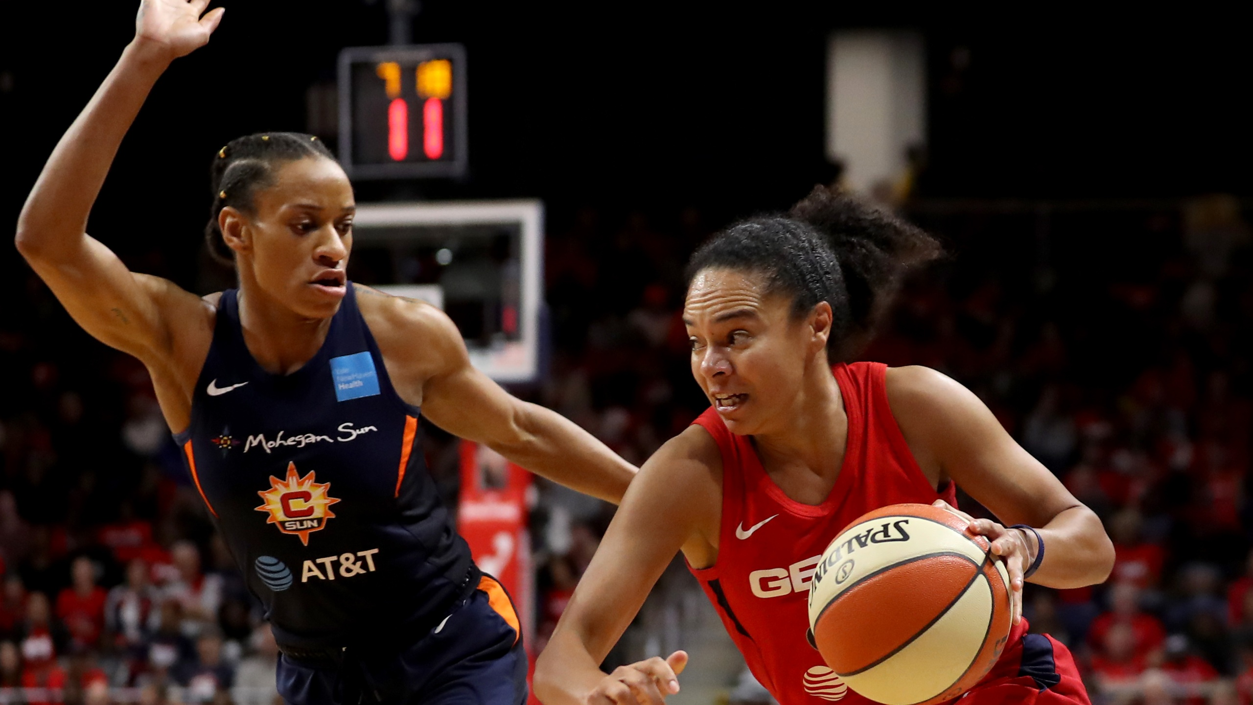 Kristi Toliver of Washington Mystics drives against Jasmine Thomas of Connecticut Sun during Game Five of the 2019 WNBA Finals at St Elizabeths East Entertainment & Sports Arena on October 10, 2019, in Washington, DC. (Rob Carr/Getty Images)