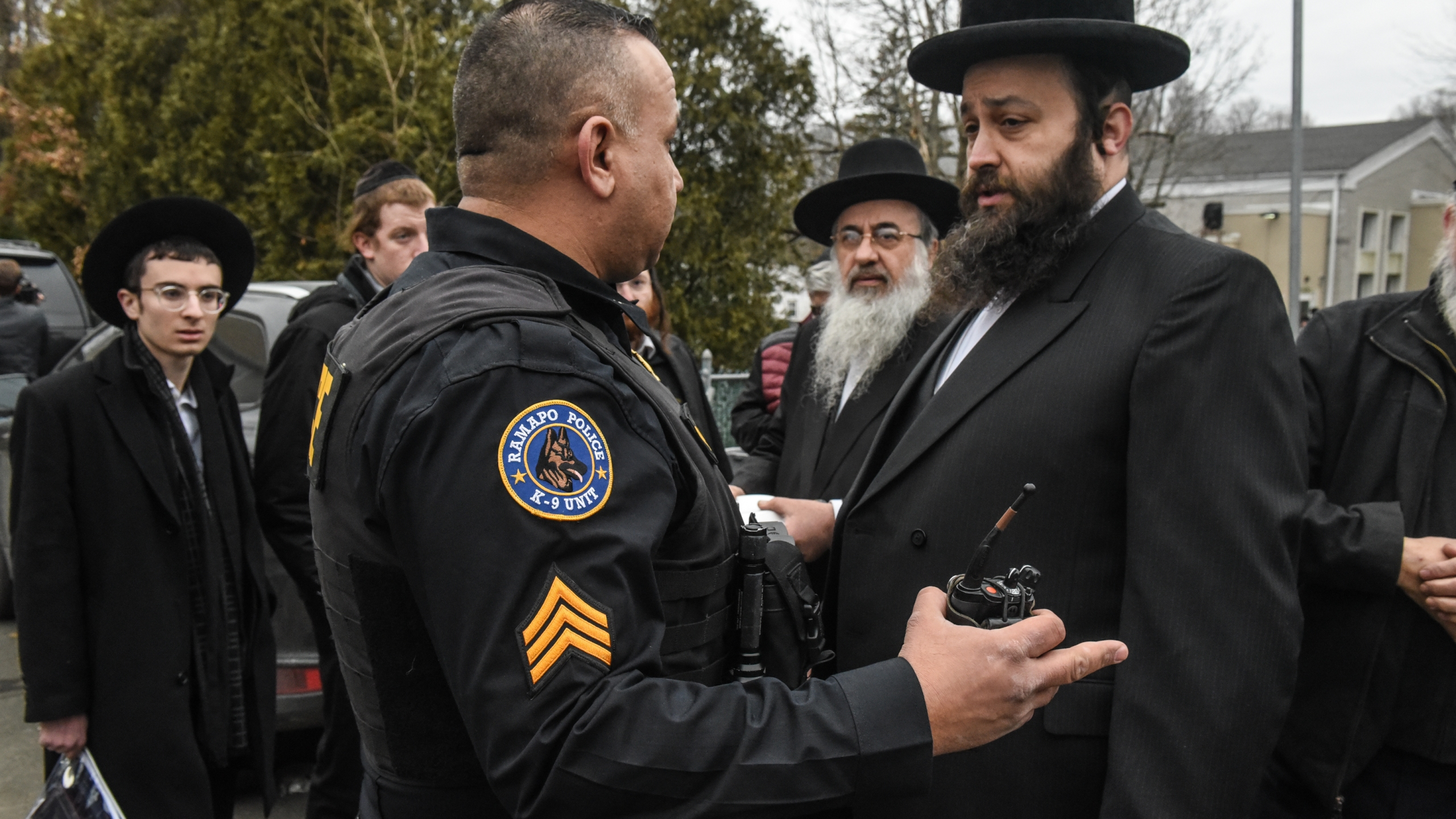 A Ramapo police officer stands guard in front of the house of Rabbi Chaim Rottenberg in Monsey, New York, on Dec. 29, 2019, after five people were injured in a knife attack. (Stephanie Keith / Getty Images)