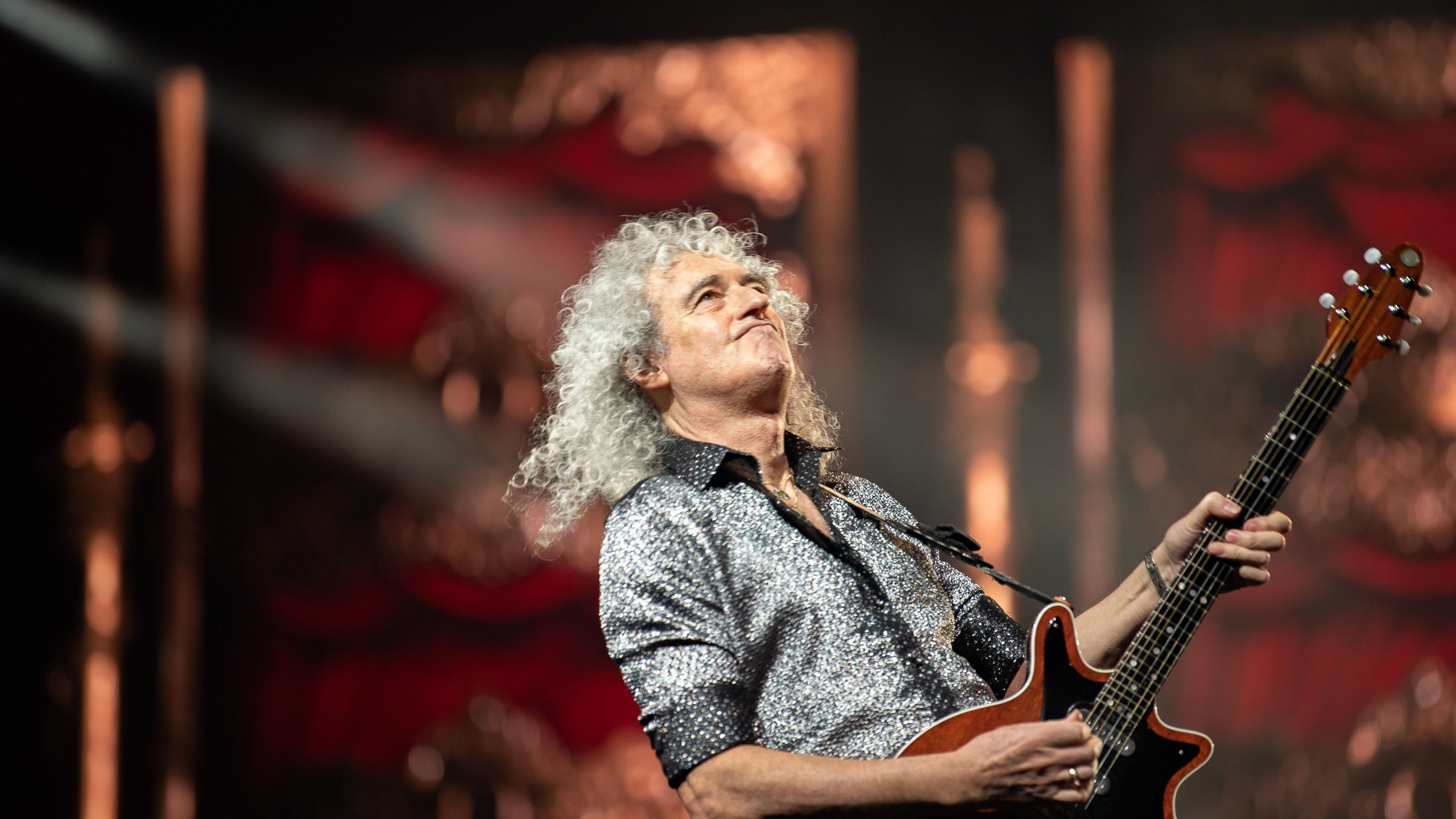 In this photo taken on January 18, 2020, Queen guitarist Brian May performs during the Queen + Adam Lambert concert in Seoul. (YELIM LEE/AFP via Getty Images)
