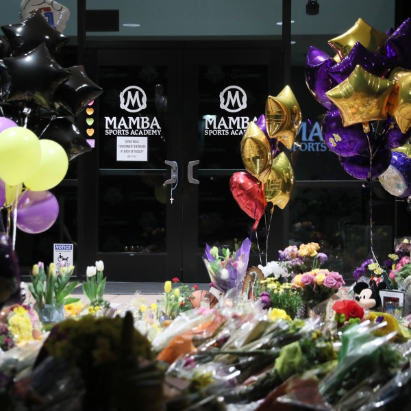 The entrance of Mamba Sports Academy in Newbury Park, Calif., is surrounded by flowers and other gifts in memory of NBA champion and two-time Olympic gold medalist Kobe Bryant, 41, his daughter, Gianna, and seven others, who died in a helicopter crash on Jan. 26, 2020. (Josh Lefkowitz/Getty Images)