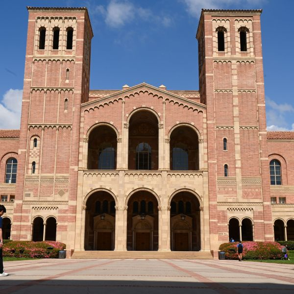 A student walks toward Royce Hall on the campus of University of California at Los Angeles on March 11, 2020. (ROBYN BECK/AFP via Getty Images)