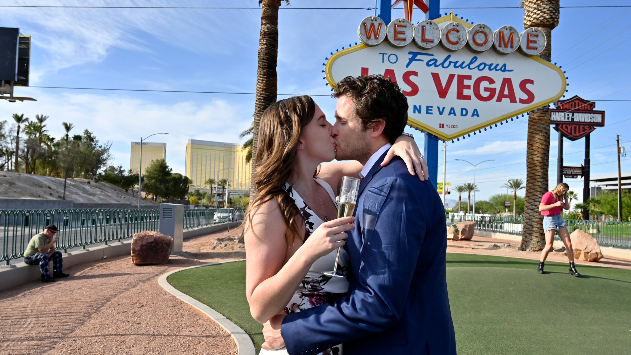 Las Vegas residents Elizabeth Billington, left, and Kenneth Quirk kiss as they celebrate what would have been their wedding day at the Welcome to Las Vegas sign on April 25, 2020. (David Becker / AFP / Getty Images)