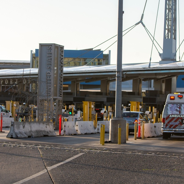 An ambulance crosses the San Ysidro sentry box border crossing in Tijuana on April 27, 2020. (Francisco Vega / Getty Images)