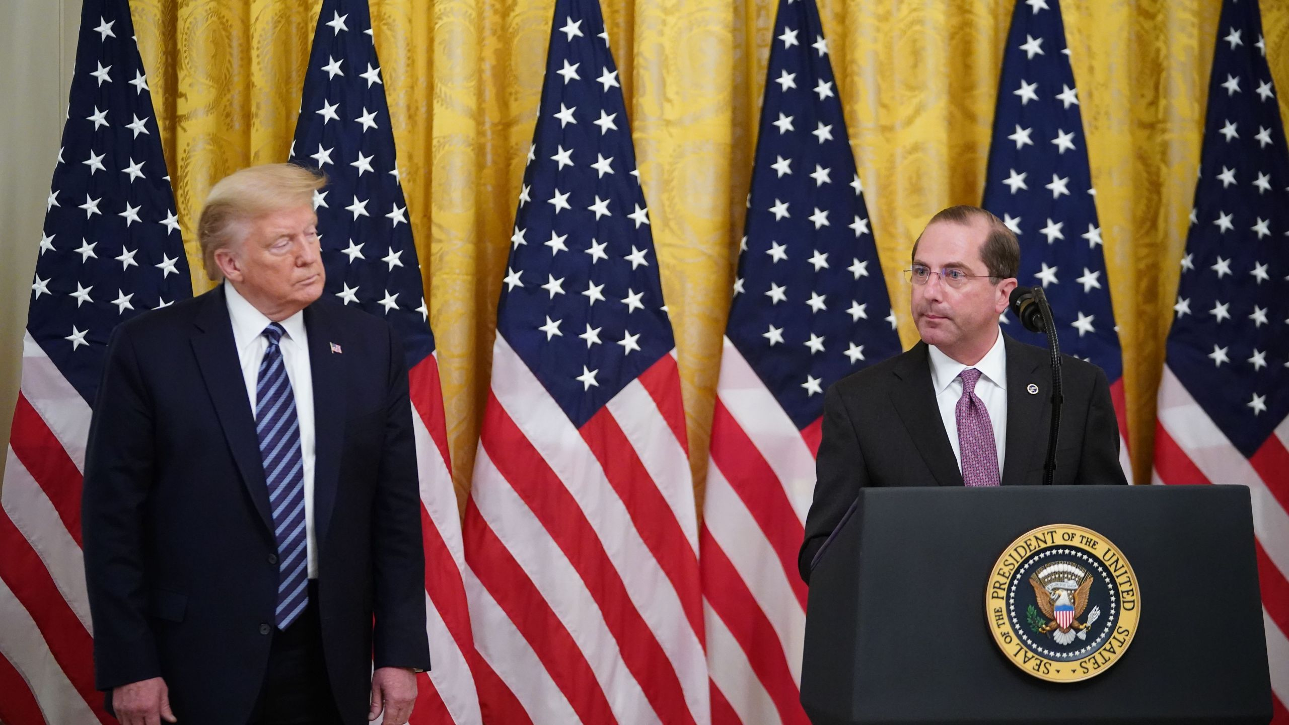 President Donald Trump listens as Secretary of Health and Human Services Alex Azar speaks on protecting Americas seniors from the COVID-19 pandemic in the East Room of the White House in Washington, D.C. on April 30, 2020. (MANDEL NGAN/AFP via Getty Images)