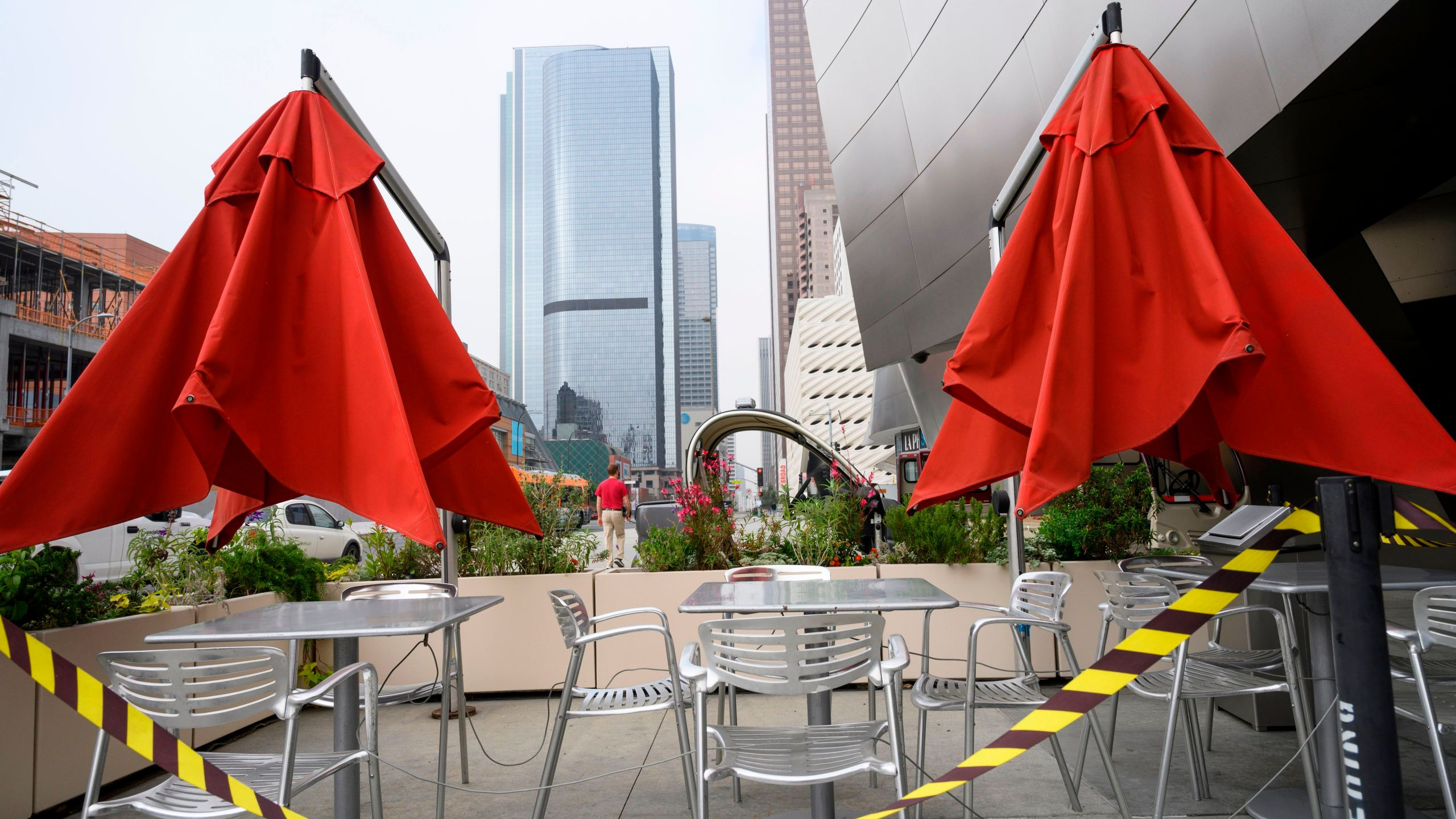 Caution tape surrounds closed outdoor restaurant cafe seating in front of the Walt Disney Concert Hall in downtown Los Angeles on April 30, 2020. (ROBYN BECK/AFP via Getty Images)