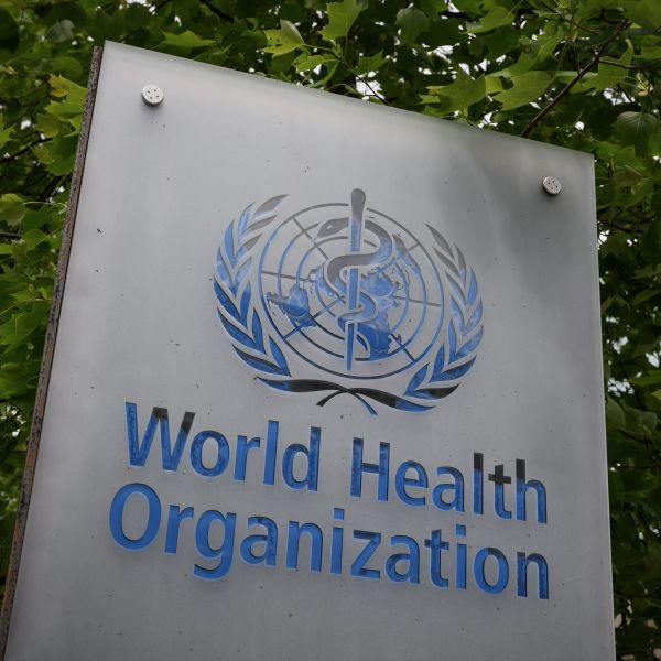 This picture taken on May 12, 2020, shows a sign of the World Health Organization (WHO) in Geneva next to their headquarters, amid the COVID-19 outbreak, caused by the novel coronavirus. (FABRICE COFFRINI/AFP via Getty Images)