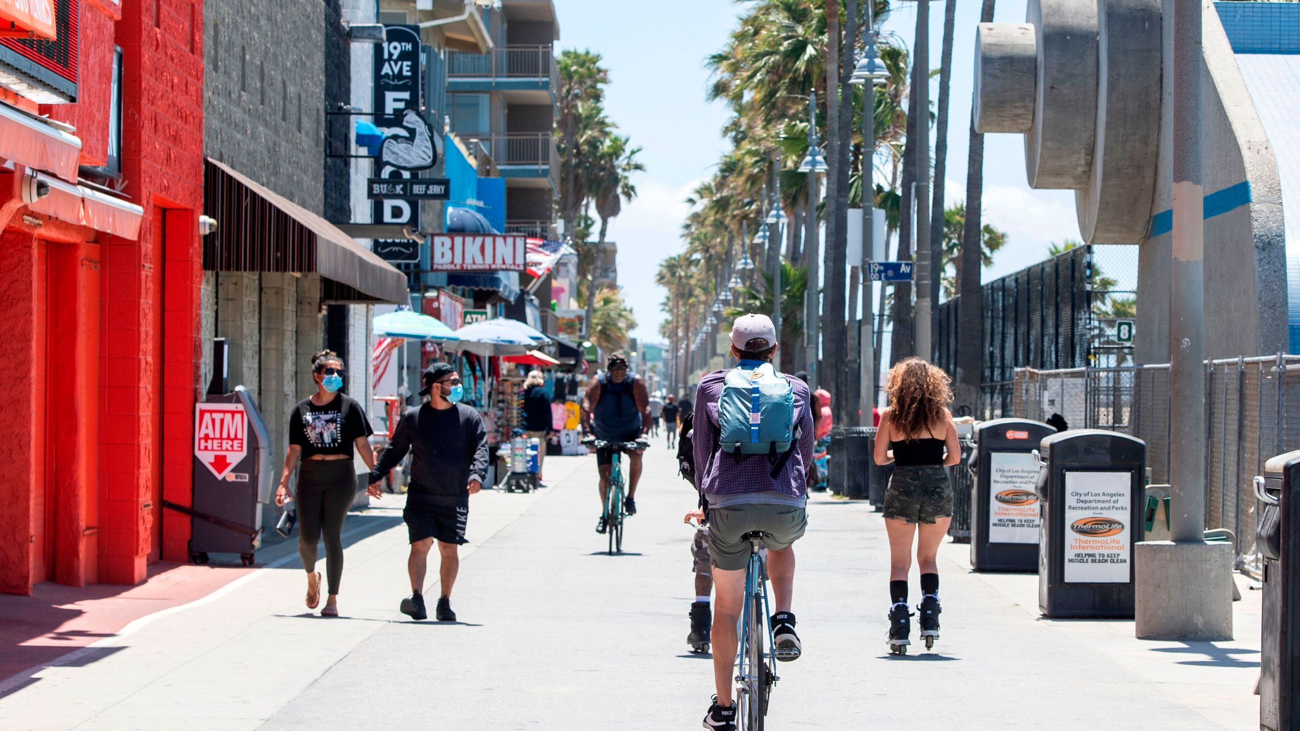 People are seen at Venice Beach on May 13, 2020. (VALERIE MACON/AFP via Getty Images)