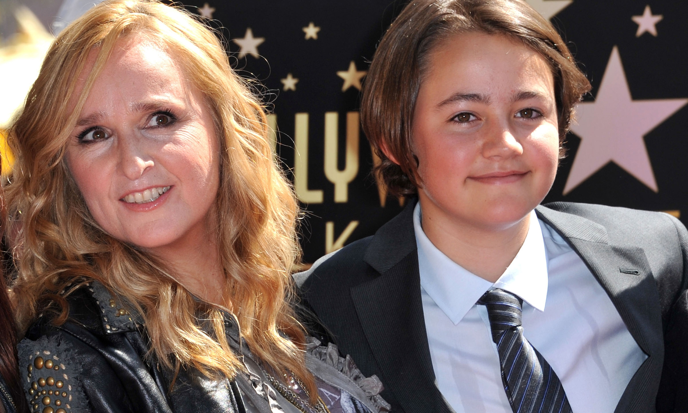 This photo taken on September 27, 2011 shows singer Melissa Etheridge posing with her son Beckett during her Walk of Fame ceremony held at the Hard Rock cafe in Hollywood. (CHRIS DELMAS/AFP via Getty Images)