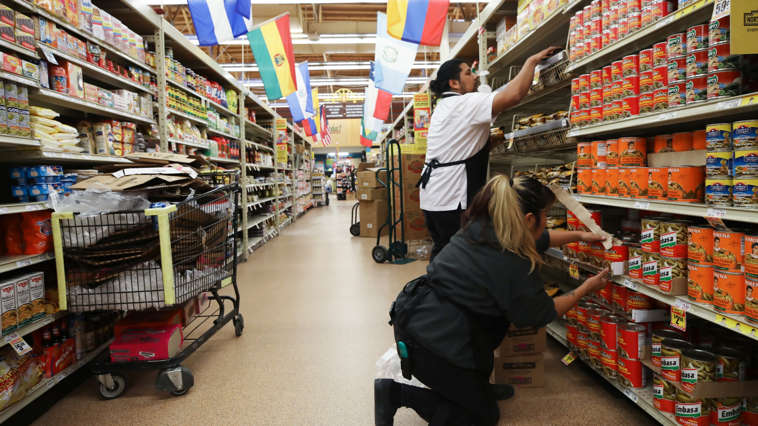 Workers restock items at Northgate Gonzalez Market on March 19, 2020 in Los Angeles. (Mario Tama/Getty Images)