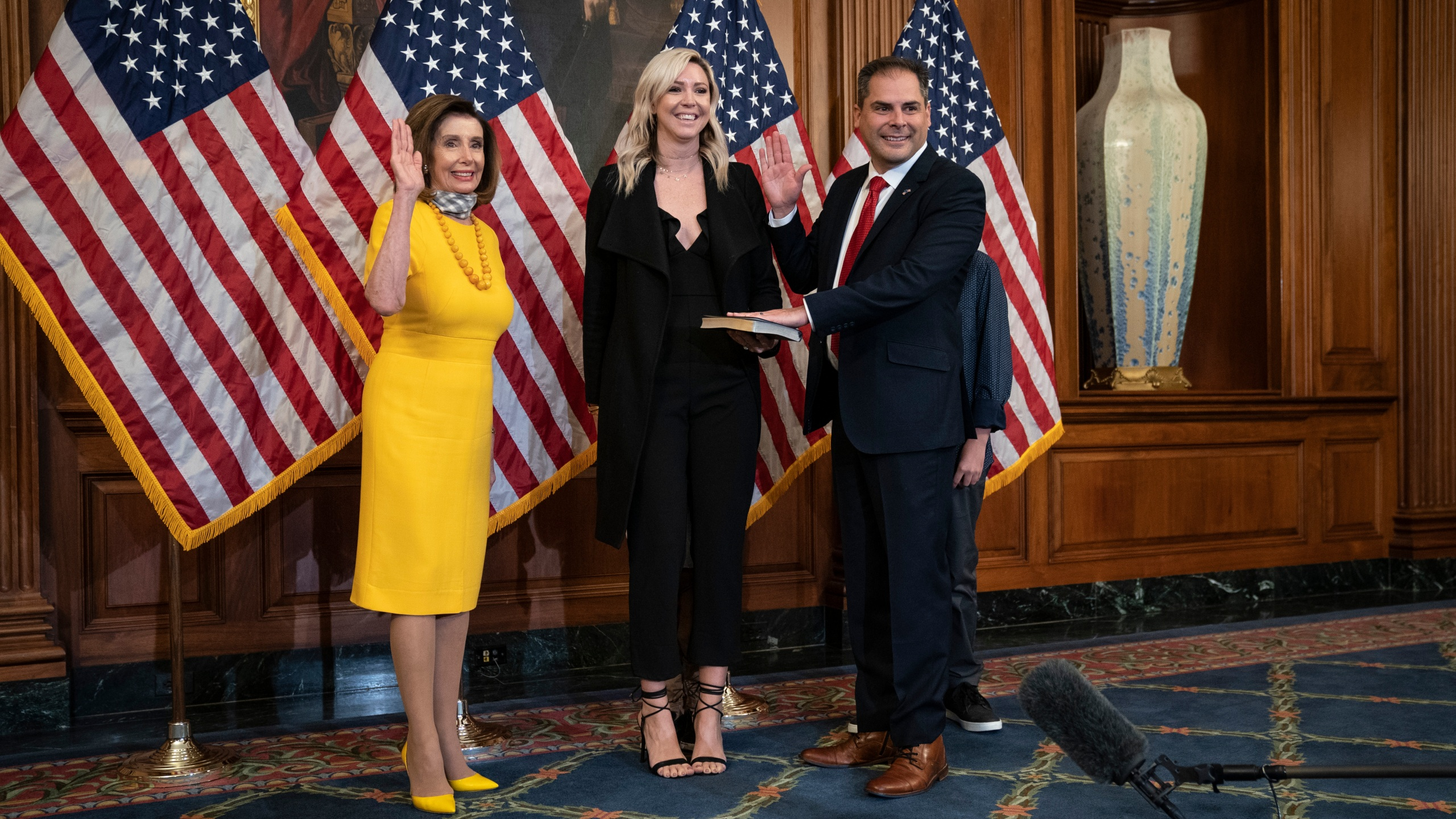 From left: Speaker of the House Nancy Pelosi participates in a ceremonial swearing-in with new Rep. Mike Garcia, with his wife Rebecca, at the U.S. Capitol on May 19, 2020 in Washington, D.C. (Drew Angerer/Getty Images)