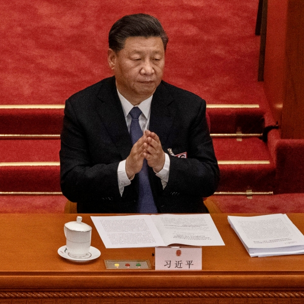 Chinese president Xi Jinping applauds as he listens to a speech at the opening of the National People's Congress at the Great Hall of the People on May 22, 2020 in Beijing, China. (Kevin Frayer/Getty Images)