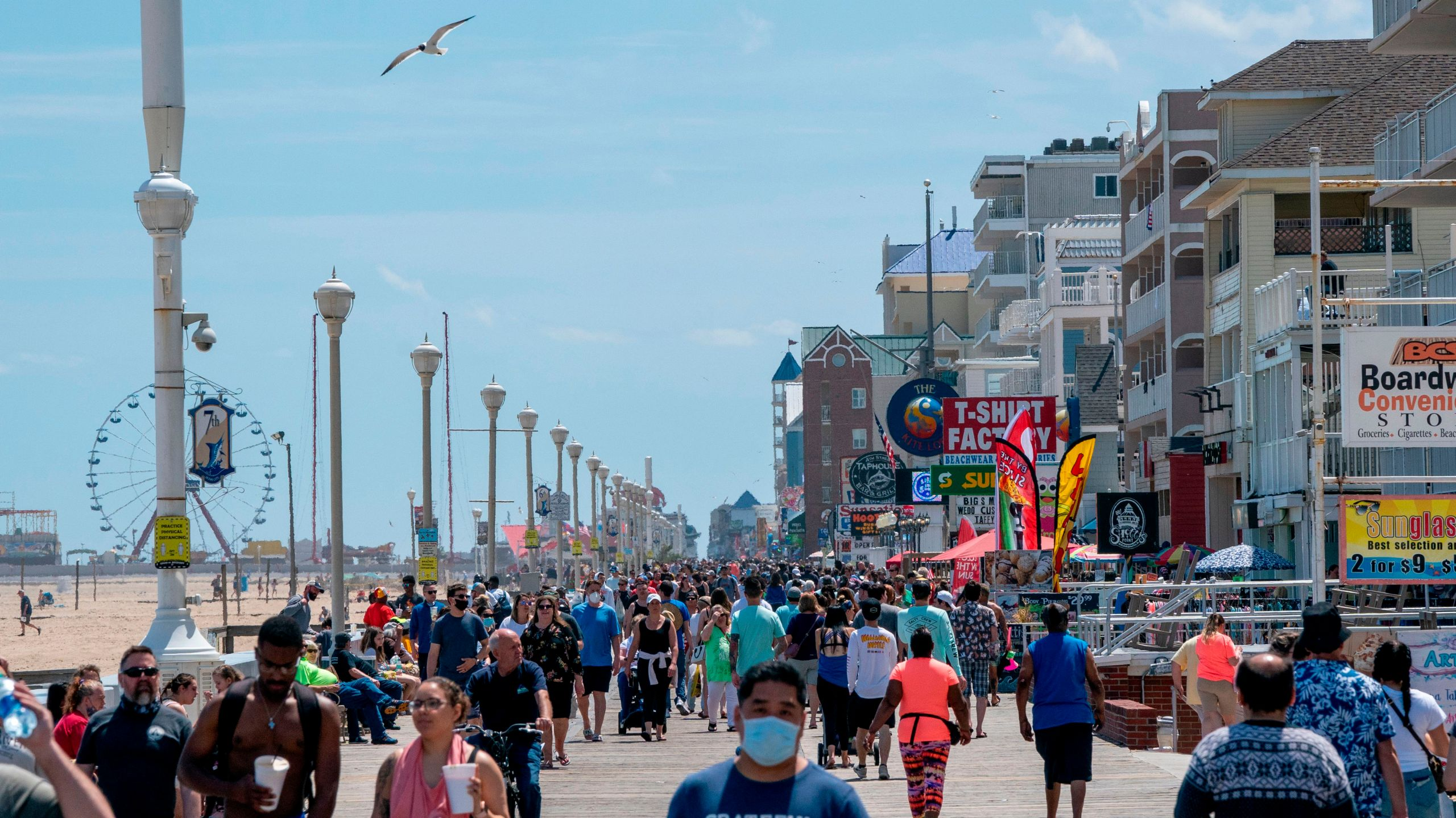 People enjoy the boardwalk during the Memorial Day holiday weekend amid the coronavirus pandemic on May 23, 2020 in Ocean City, Maryland. (ALEX EDELMAN/AFP via Getty Images)