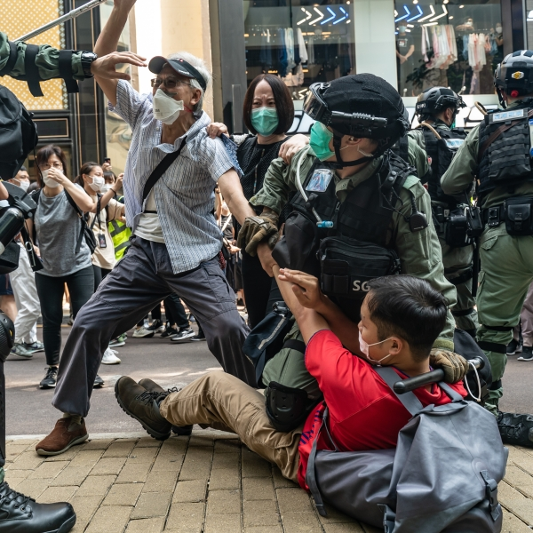 Pro-democracy supporters scuffle with riot police during an detention at a rally in Causeway Bay district on May 27, 2020 in Hong Kong, China. (Anthony Kwan/Getty Images)