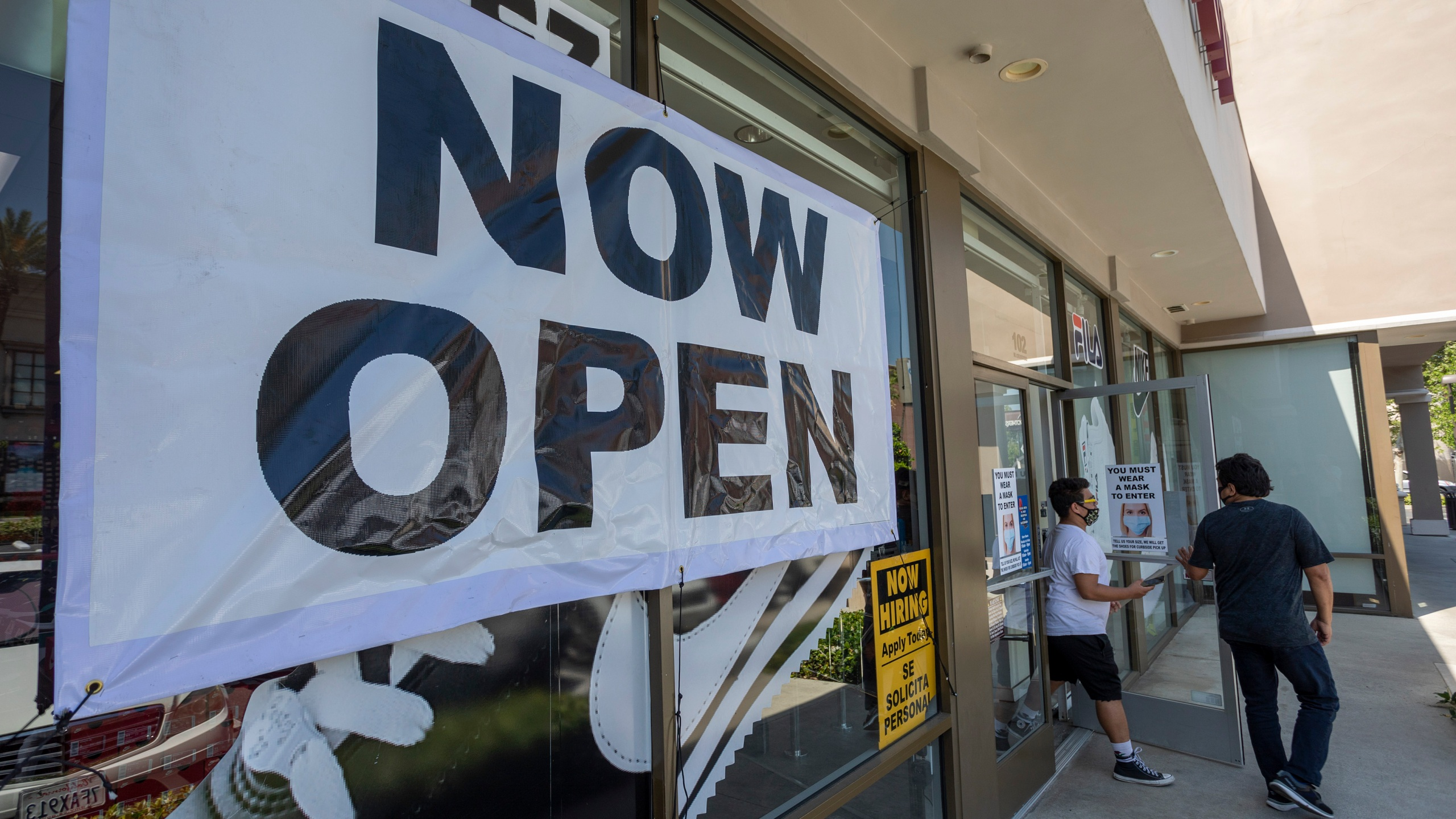 People exit a Shoe City store in Glendale as Los Angeles County retail businesses reopen while the COVID-19 pandemic continues on May 27, 2020. (David McNew/Getty Images)