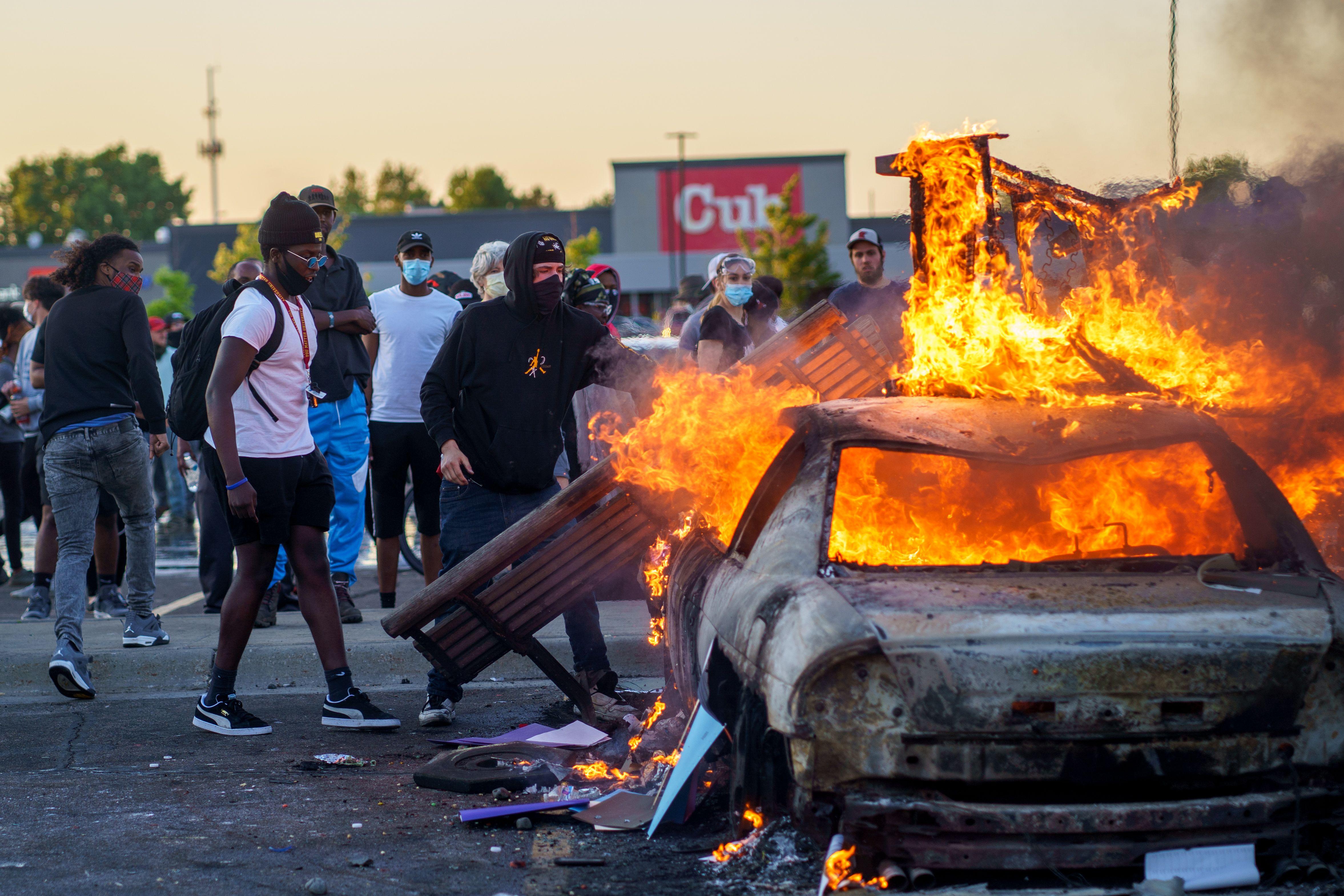 Minneapolis police precinct burns as violent protests continue ...