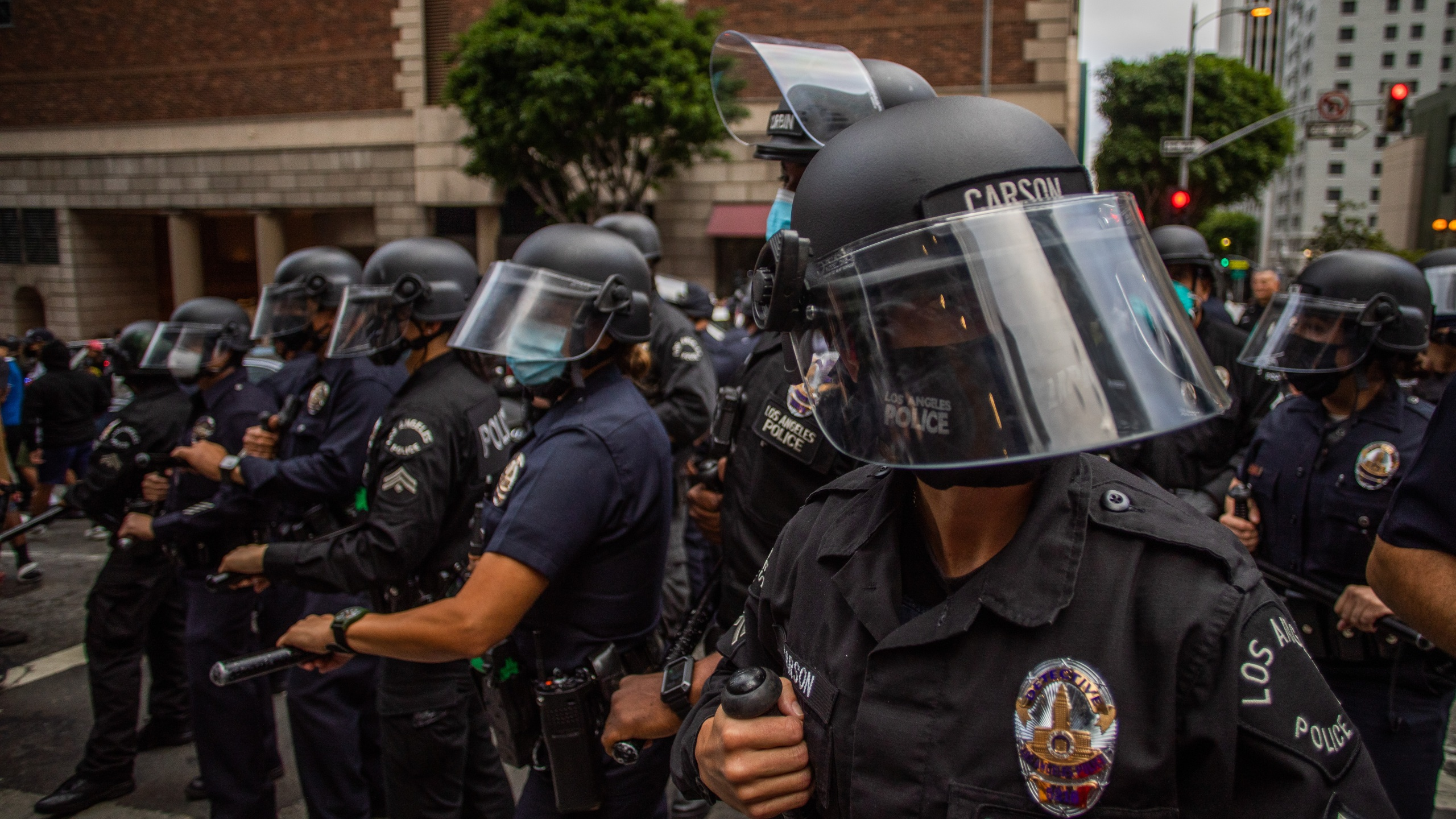 Police officers look on during a protest in response to the police killing of George Floyd on May 29, 2020 in Los Angeles, California. (Apu Gomes/Getty Images)