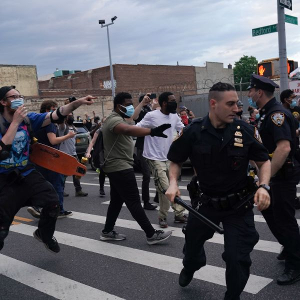 NYPD officers and protesters clash during a demonstration against the killing of George Floyd by Minneapolis police on Memorial Day, on May 30, 2020, in the borough of Brooklyn. (BRYAN R. SMITH/AFP via Getty Images)