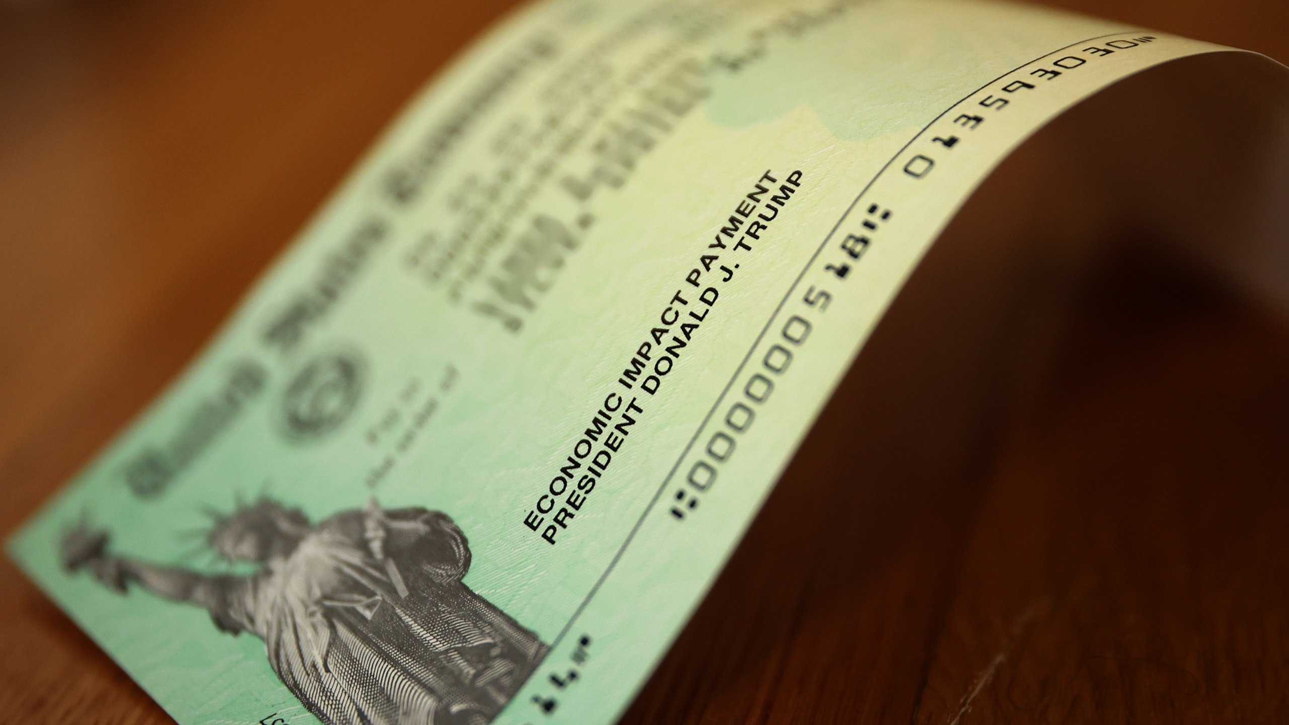 President Donald Trump's name appears on the coronavirus economic assistance checks that were sent to citizens across the country April 29, 2020 in Washington, DC. (Chip Somodevilla/Getty Images)