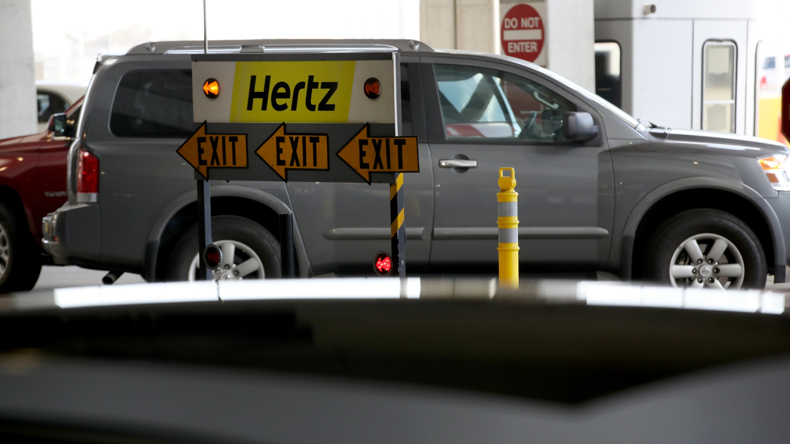 A sign is posted at the Hertz Rent-A-Car rental lot at San Francisco International Airport on April 30, 2020, in San Francisco, California. (Justin Sullivan/Getty Images)