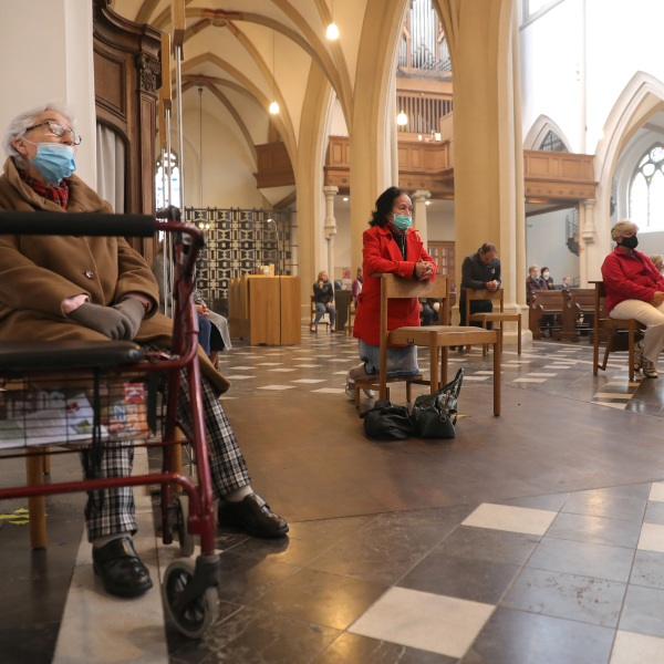 A limited number of people, wearing protective face masks, attend a Sunday mass by Dean Wolfgang Picken at St. Remigius Catholic church for the first time since March during the novel coronavirus crisis on May 3, 2020 in Bonn, Germany. (Andreas Rentz/Getty Images)