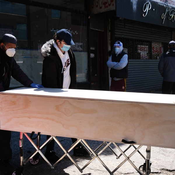 A casket of a Muslim man, who recently passed away from what is believed to be coronavirus, is brought to a van for burial at a busy Brooklyn funeral home on May 9, 2020 in New York City. (Spencer Platt/Getty Images)
