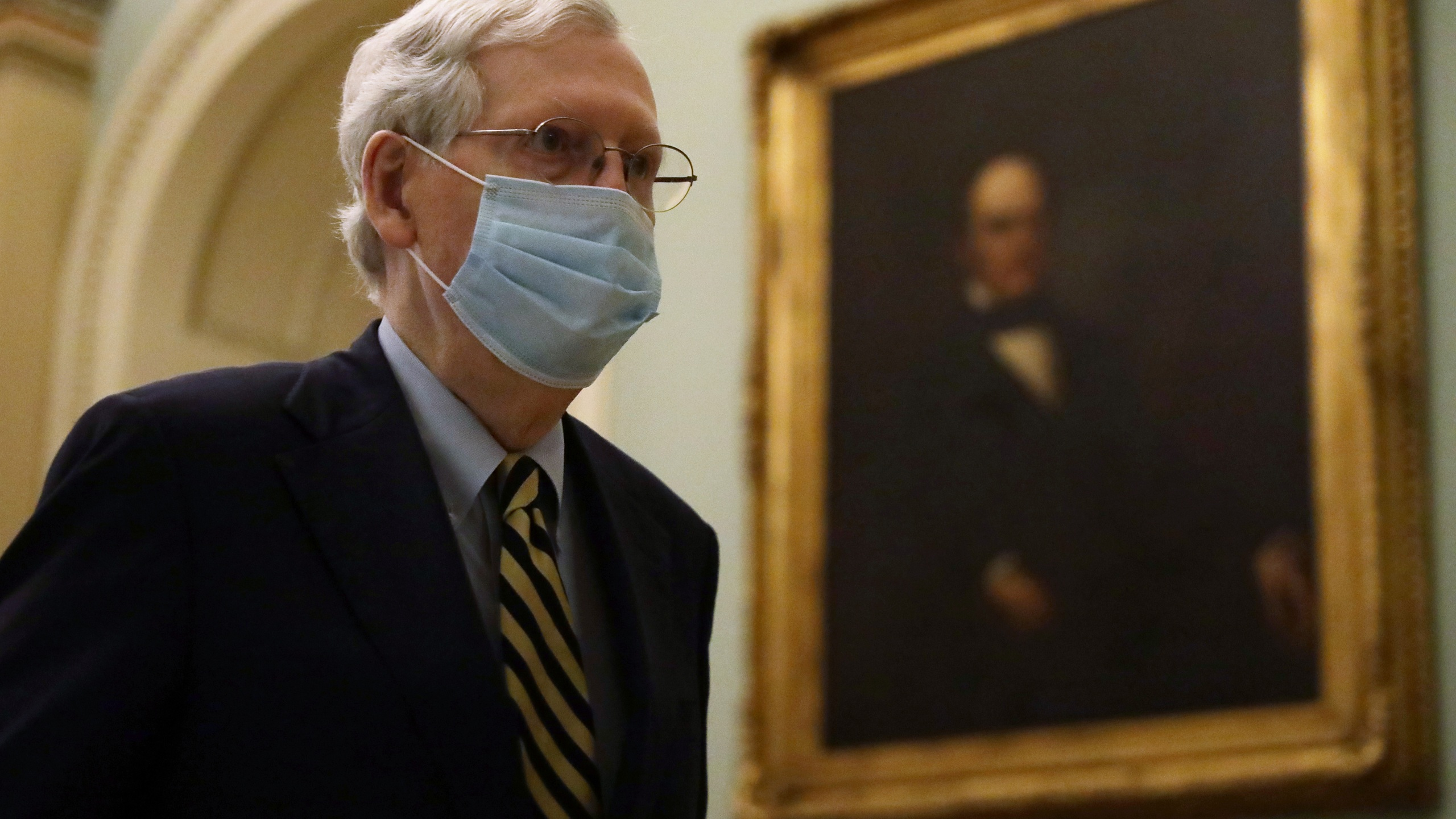 U.S. Senate Majority Leader Sen. Mitch McConnell wears a mask as he walks through a hallway at the U.S. Capitol May 11, 2020, in Washington, DC. (Alex Wong/Getty Images)