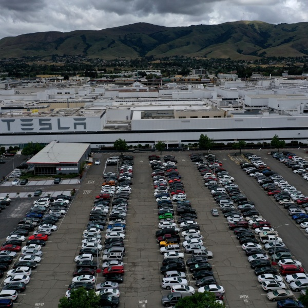 The parking lot is full outside the Tesla factory in Fremont on May 12, 2020, despite a county stay-home order. (Justin Sullivan / Getty Images)