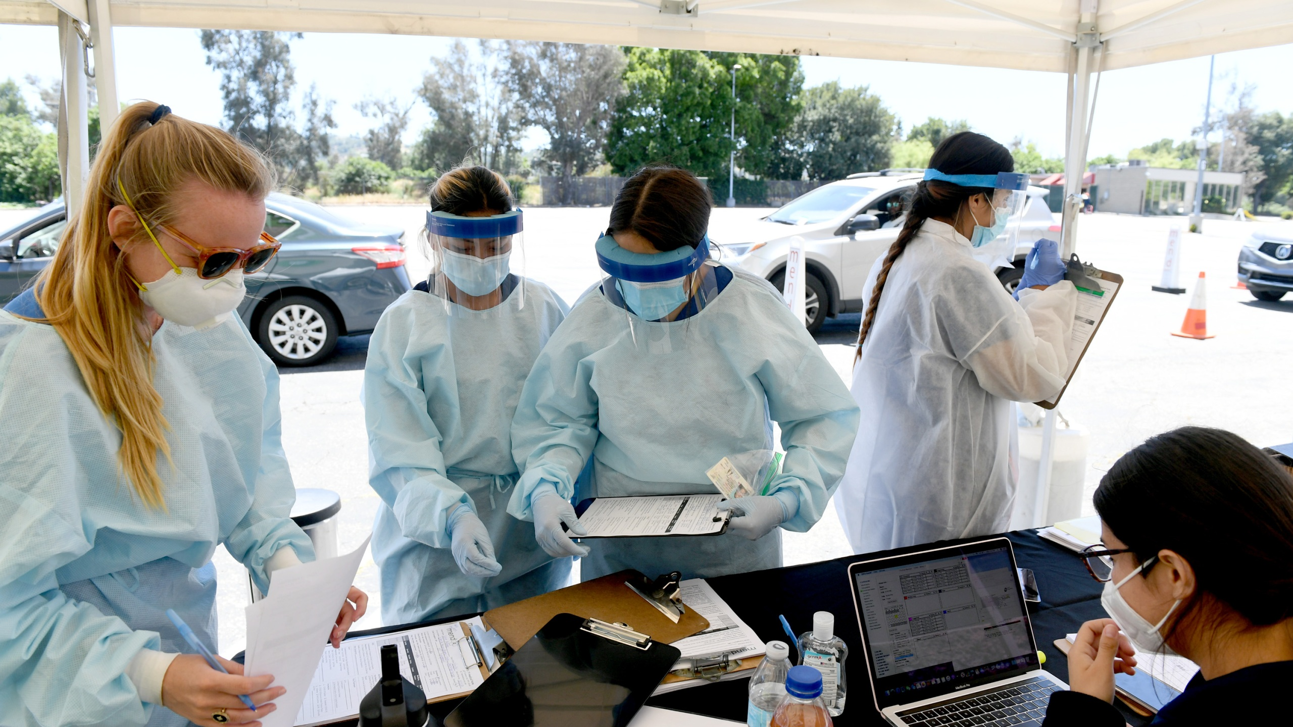 Workers perform drive-up coronavirus testing at the Westfield Fashion Square on May 13, 2020, in Sherman Oaks. (Kevin Winter/ Getty Images)