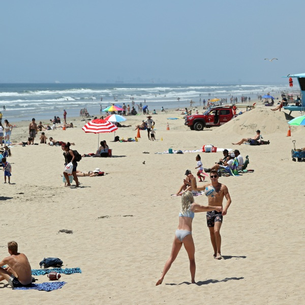 People gather at the beach amid the coronavirus pandemic on May 15, 2020 in Huntington Beach, California. (Michael Heiman/Getty Images)