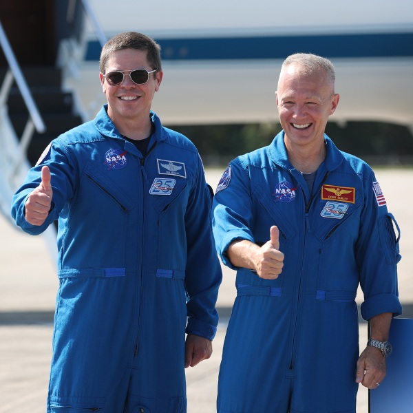 NASA astronauts Bob Behnken (left) and Doug Hurley (right) pose for the media after arriving at the Kennedy Space Center on May 20, 2020, in Cape Canaveral, Florida. (Joe Raedle/Getty Images)