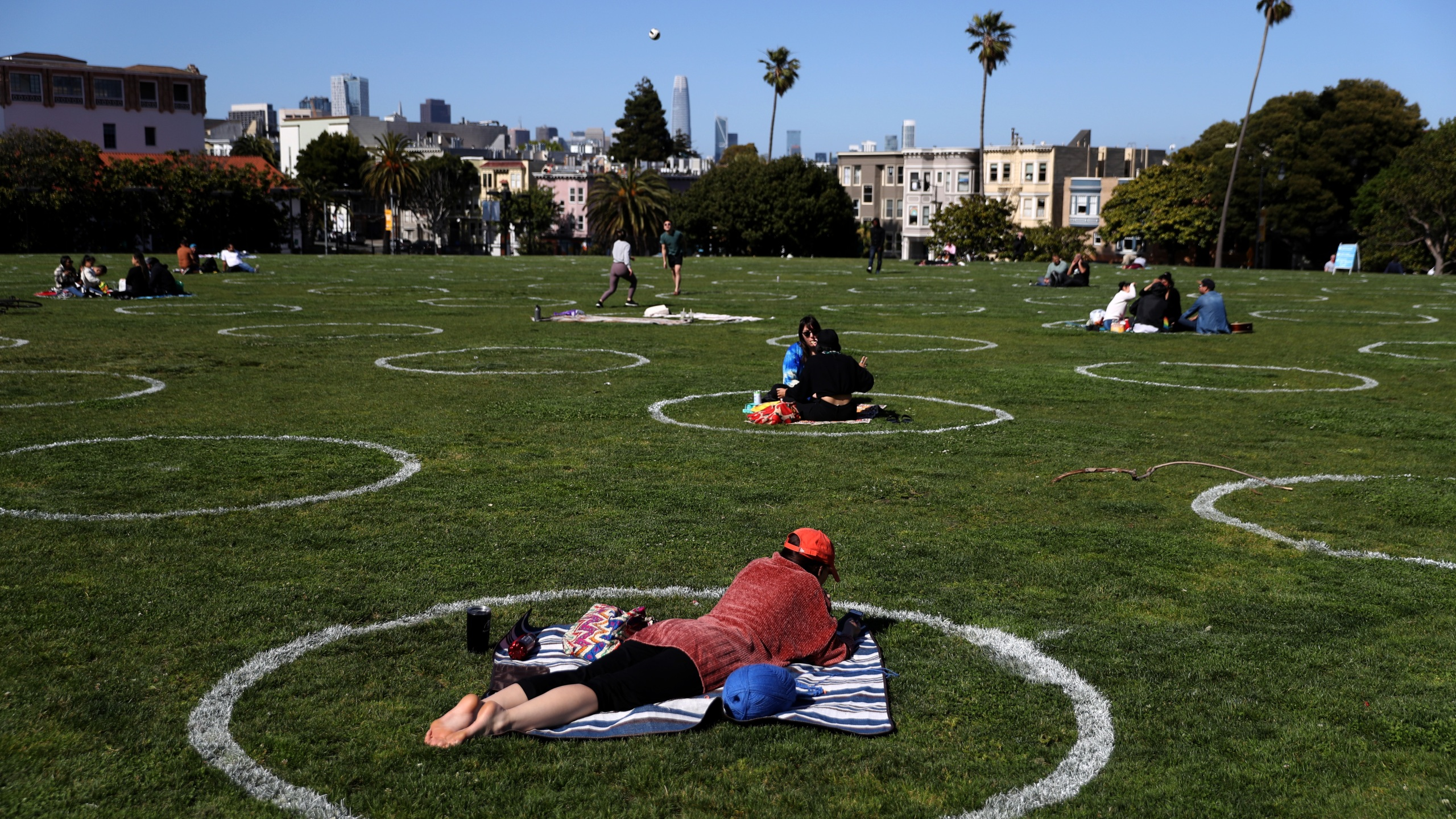 People sit in social distancing circles at Dolores Park on May 20, 2020, in San Francisco, California. (Justin Sullivan/Getty Images)