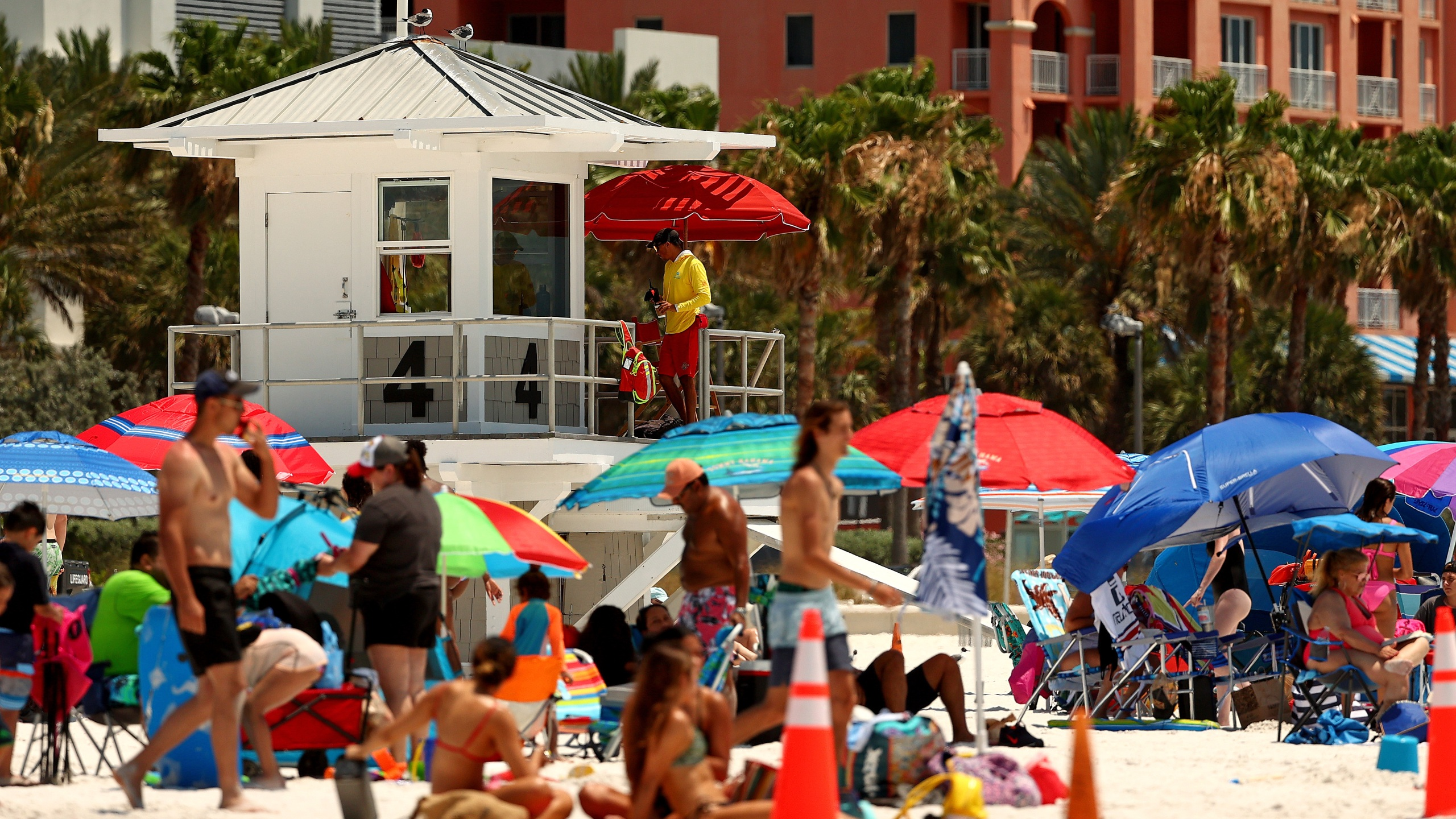 People visit Clearwater Beach on May 20, 2020, in Clearwater, Fla. Florida opened its beaches as part of Phase 1 of its reopening. (Mike Ehrmann/Getty Images)