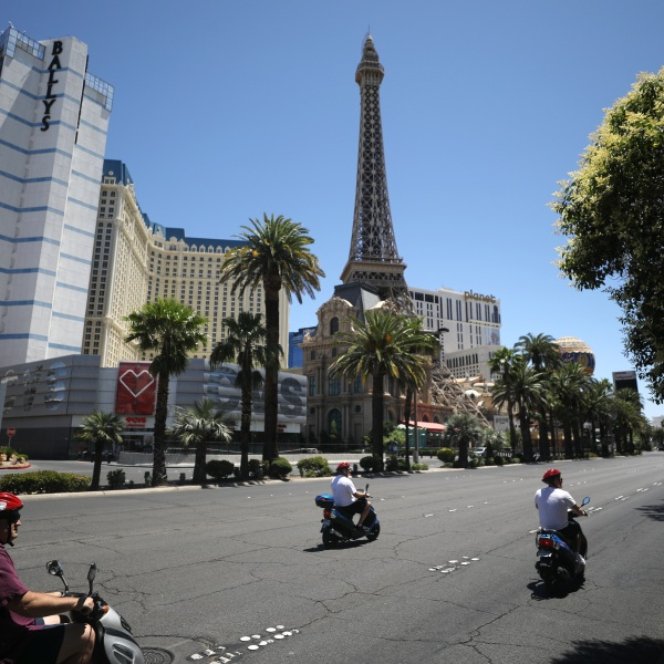 People on scooters ride on the quiet Las Vegas Strip on May 24, 2020. (Mario Tama/Getty Images)