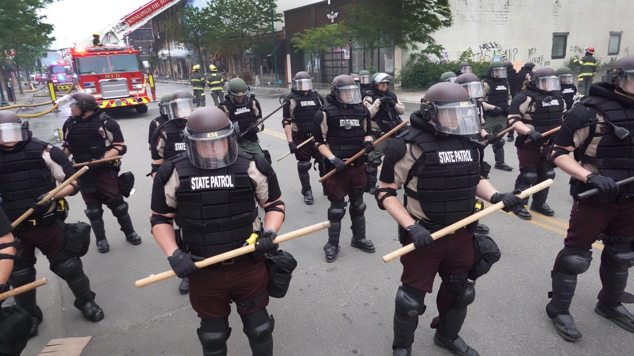 Police in Minneapolis, Minnesota secure a perimeter on May 29, 2020 following a night of rioting sparked by the death of George Floyd. (Photo by Scott Olson/Getty Images)