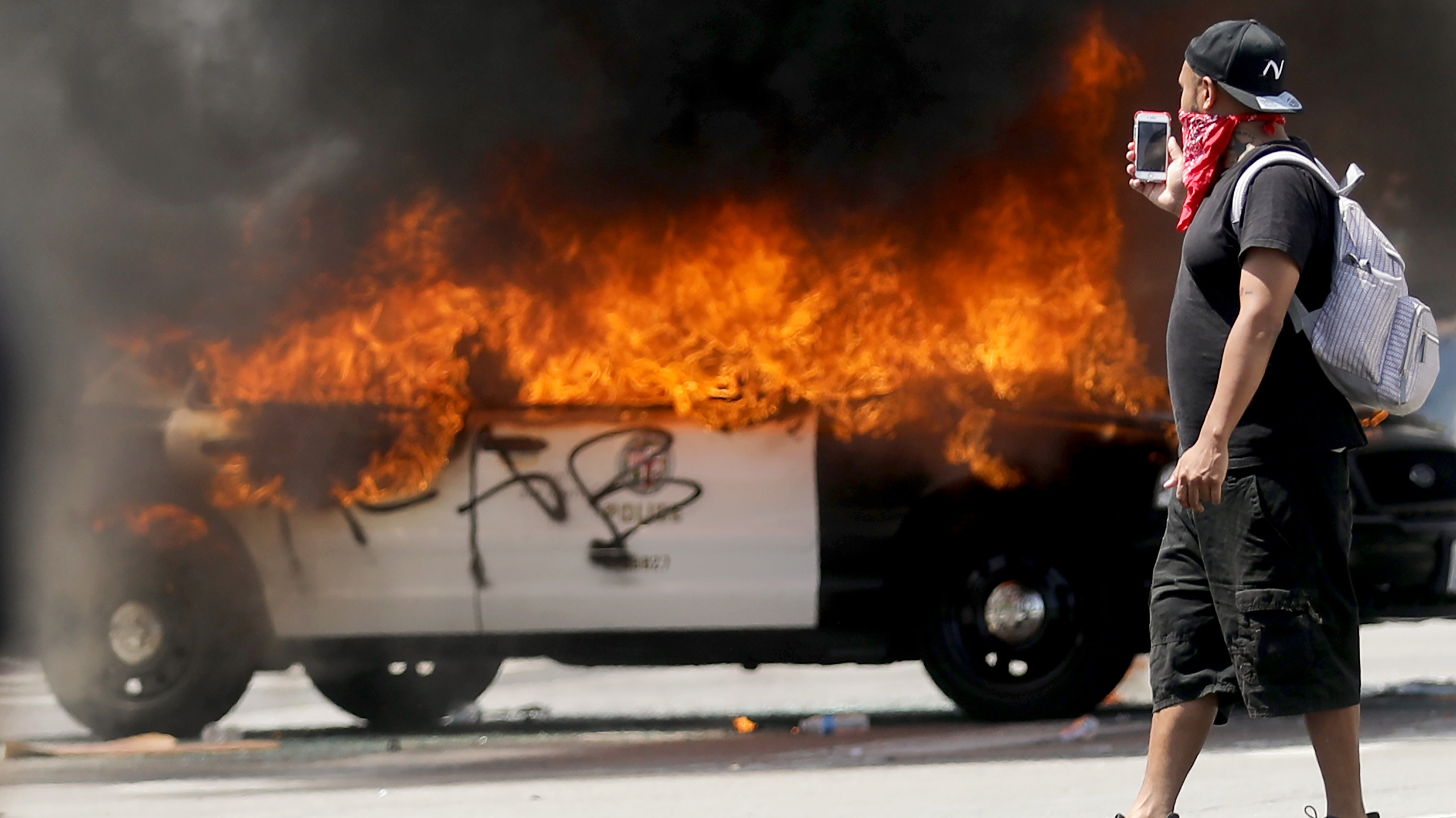An LAPD vehicle burns after being set alight by protestors during demonstrations centered in the Fairfax District following the death of George Floyd on May 30, 2020. The vast majority of protestors demonstrated peacefully. (Mario Tama/Getty Images)