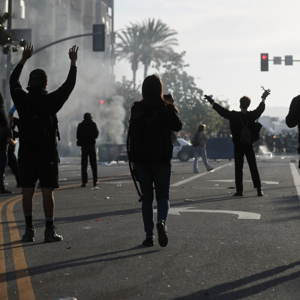 Protesters raise their hands during demonstrations following the death of George Floyd on May 30, 2020, in Los Angeles. (Mario Tama/Getty Images)