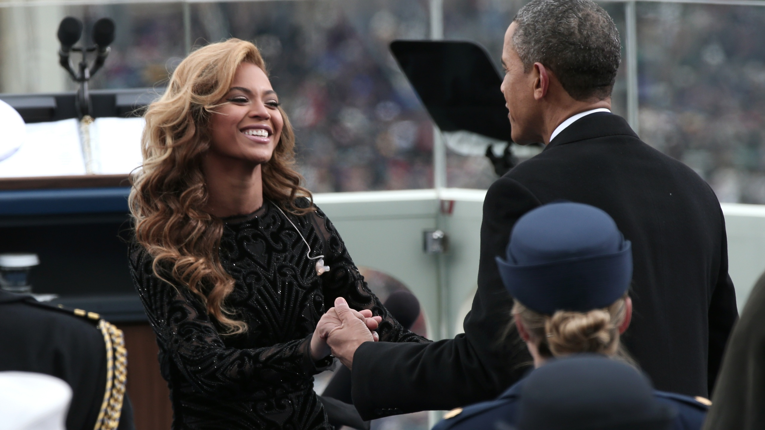 President Barack Obama greets singer Beyonce after she performs the National Anthem during the public ceremonial inauguration on the West Front of the U.S. Capitol Jan. 21, 2013. (Win McNamee/Getty Images)
