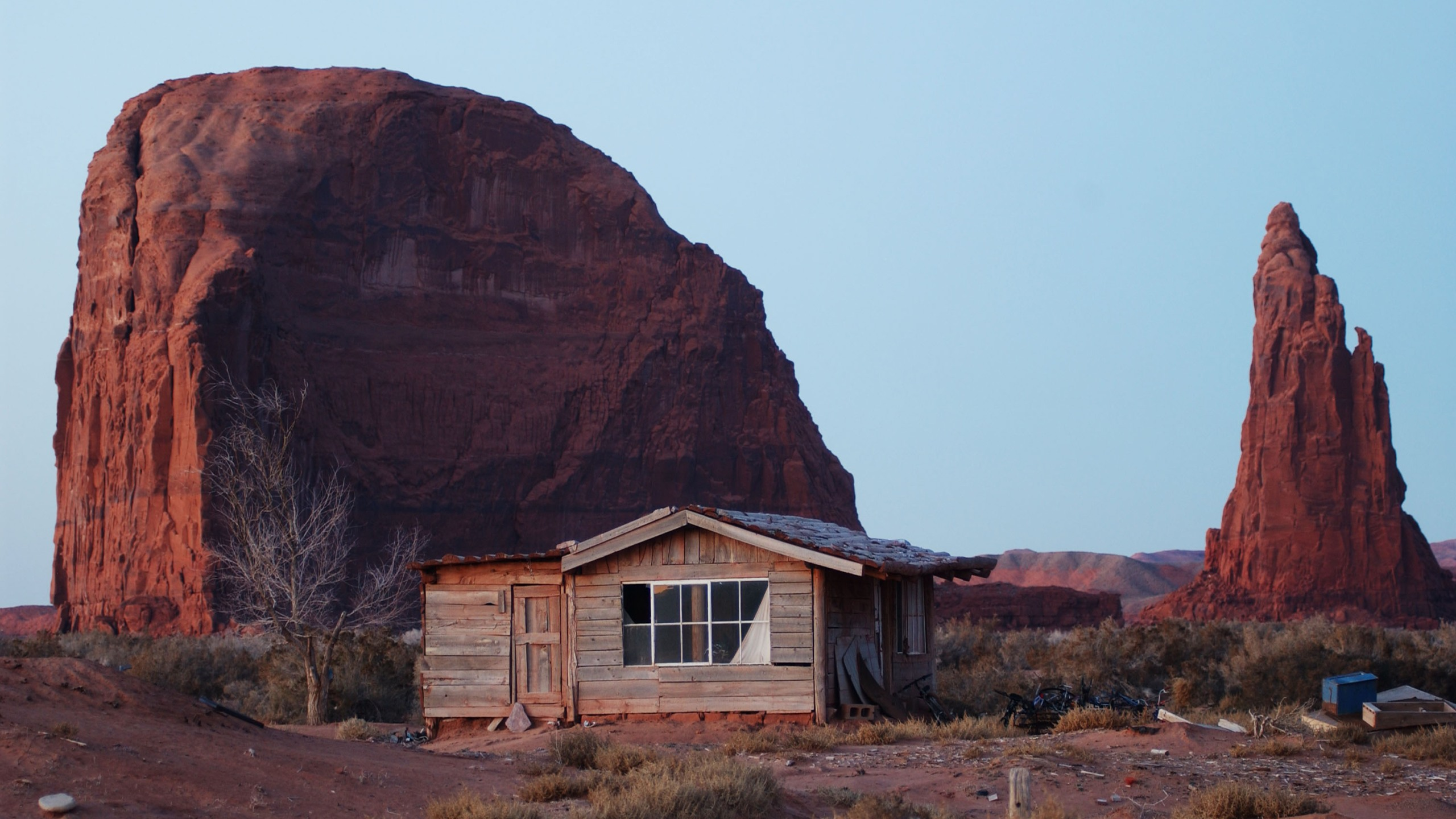 A house stands near sandstone formations south of Rock Point on the Navajo Reservation in Arizona on Dec. 5, 2002. (David McNew/Getty Images)