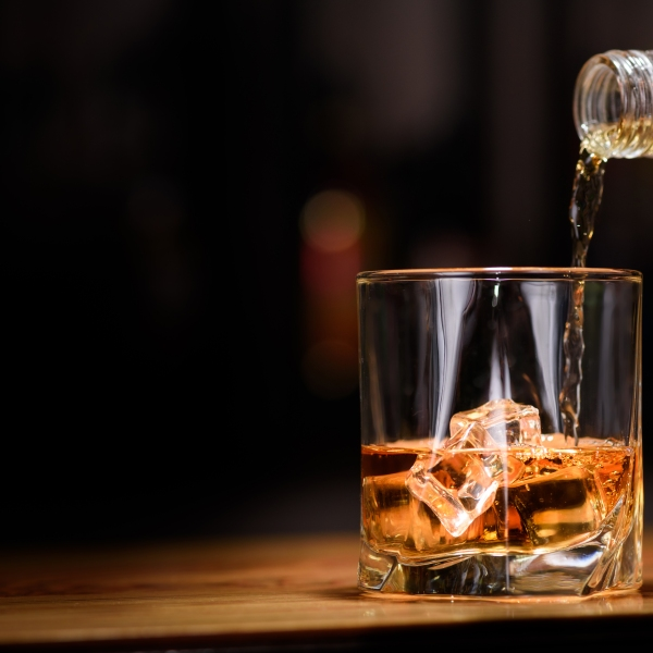 A file photo of an alcoholic beverage being poured into glass. (iStock/Getty Images Plus)