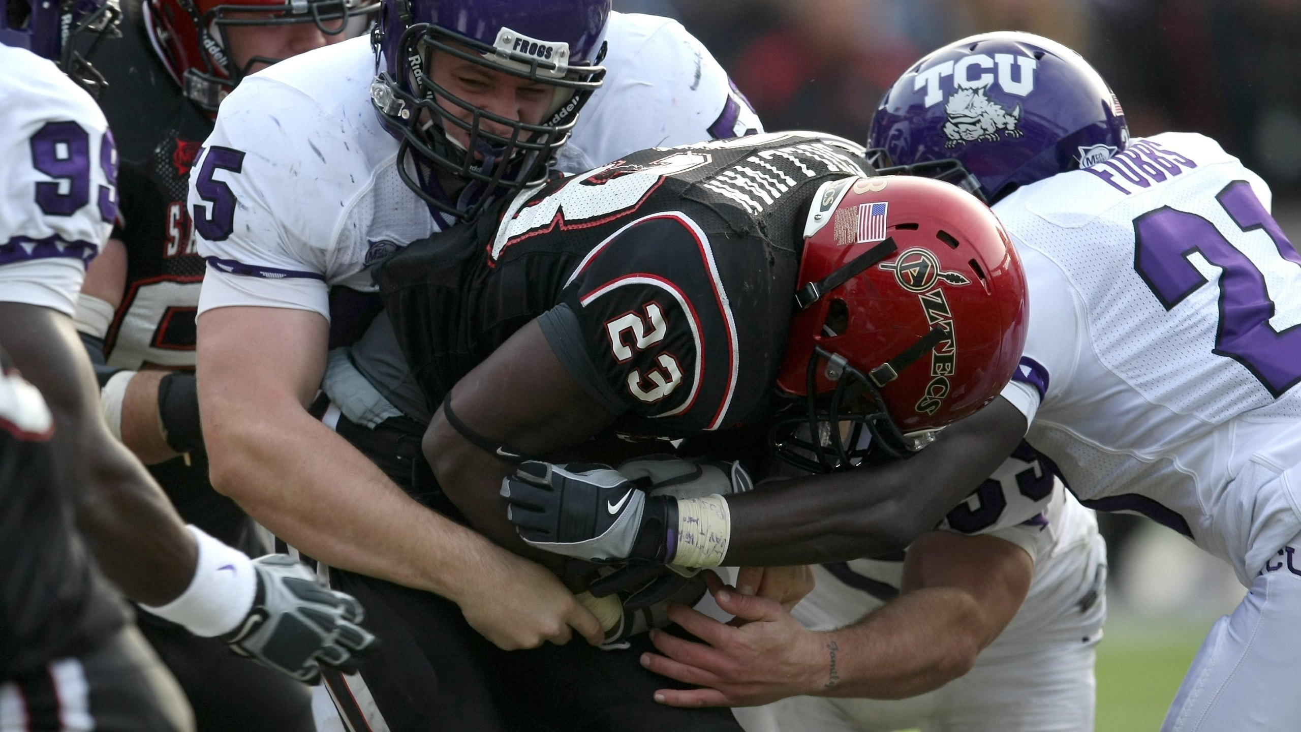 Defensive lineman D.J. Yendrey #55 of the Texas Christian University Horned Frogs tackles running back Brandon Sullivan #23 of the San Diego State Aztecs on November 7, 2009, at Qualcomm Stadium in San Diego, California. (Stephen Dunn/Getty Images)