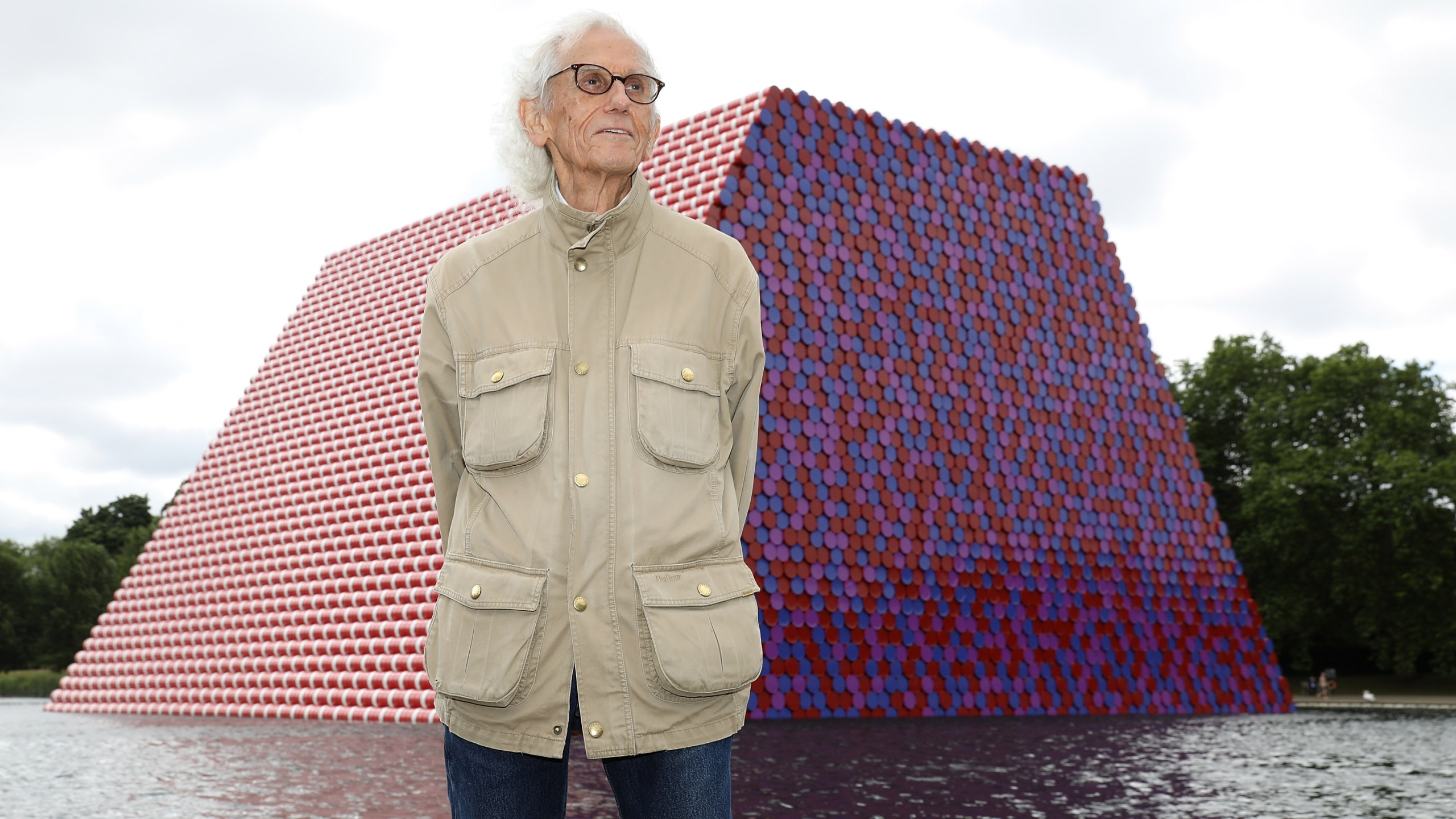 Artist Christo unveils his first UK outdoor work, a 20 meter high installation on Serpentine Lake, on June 18, 2018, in London, England. (Tim P. Whitby / Getty Images for Serpentine Galleries)