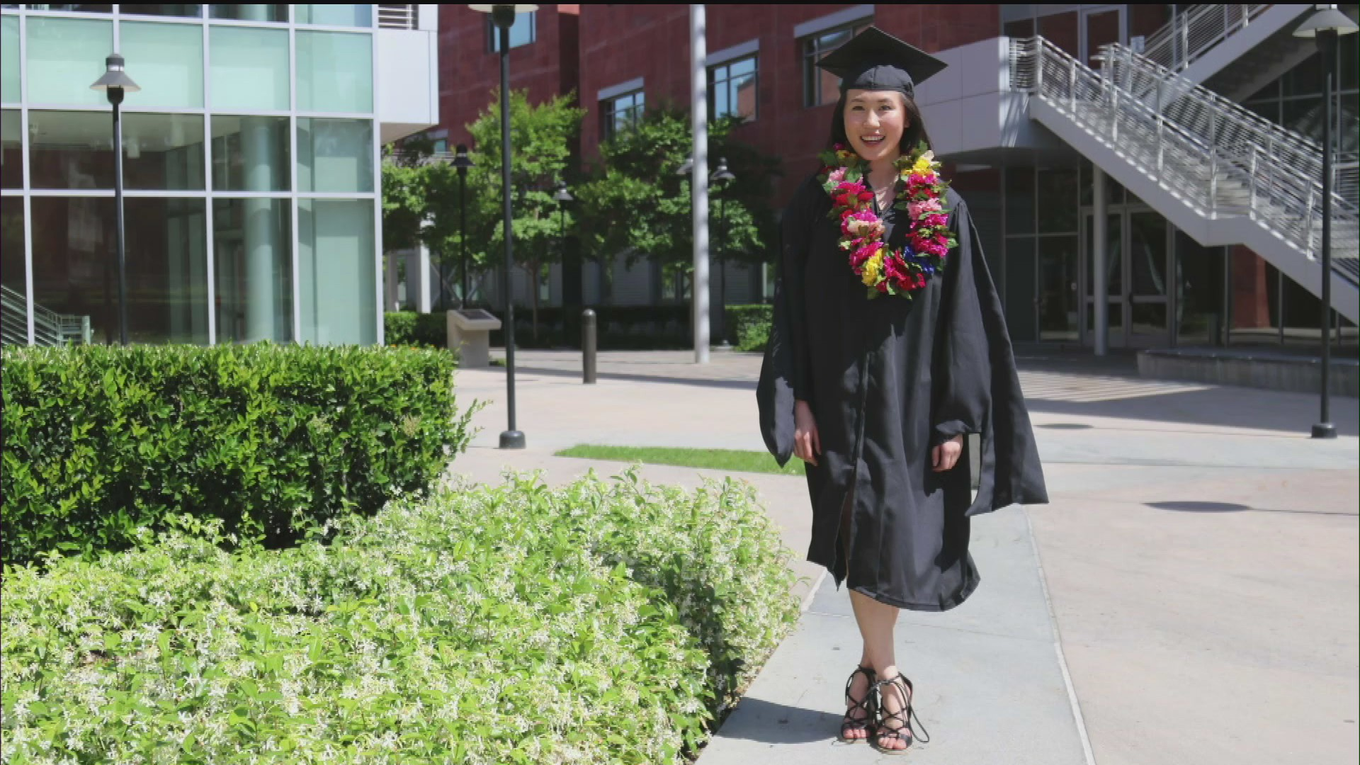 Alexis Kam, 17, of Studio City celebrates her graduation from California State University, Los Angeles in a photo obtained by KTLA.
