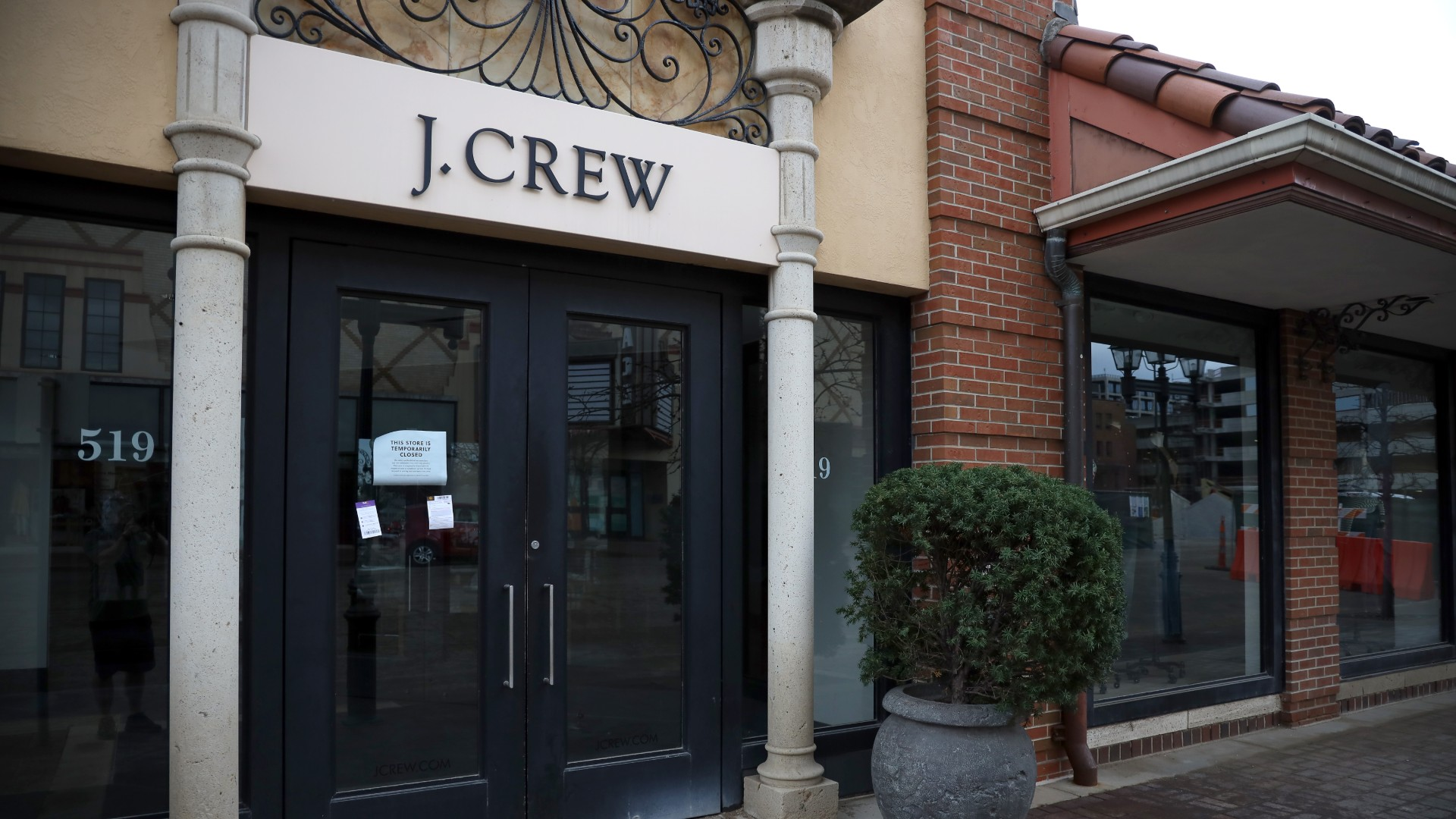 A closed sign is seen in the entrance of the J. Crew store at Country Club Plaza as the Coronavirus Pandemic causes a climate of anxiety and changing routines in America on April 02, 2020 in Kansas City, Missouri. (Jamie Squire/Getty Images)