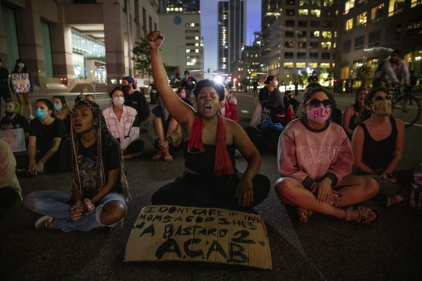 Elyssa Wells and others protest on Grand Avenue in downtown Los Angeles on May 28, 2020. (Robert Gauthier/Los Angeles Times)